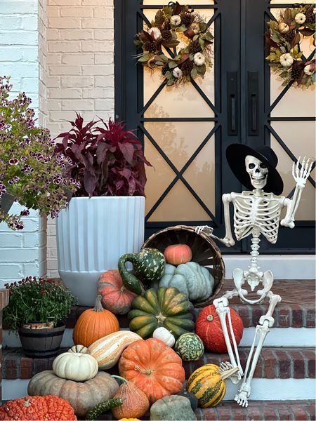 Fall/Halloween front porch decor. My fav fluted pots/urns are on sale & come in small and large sizes. Mine is the large.  Life size skeleton is a must! Fav fall door wreaths. Second season using them.   #LTKhome #LTKstyletip #LTKSeasonal