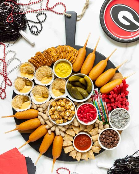 The perfect snack board for fall is a tailgating board! Cheese board charcuterie board kids board Georgia bulldogs Walmart plus Walmart finds pom poms party idea party food entertaining idea Friday night lights  #LTKhome #LTKfamily #LTKunder50