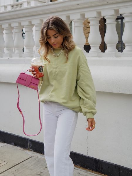 Oversized green sweatshirt teamed with white wide leg jeans is always a good idea! I finished the look off with my jacquemus bambino bag     #LTKSeasonal #LTKeurope