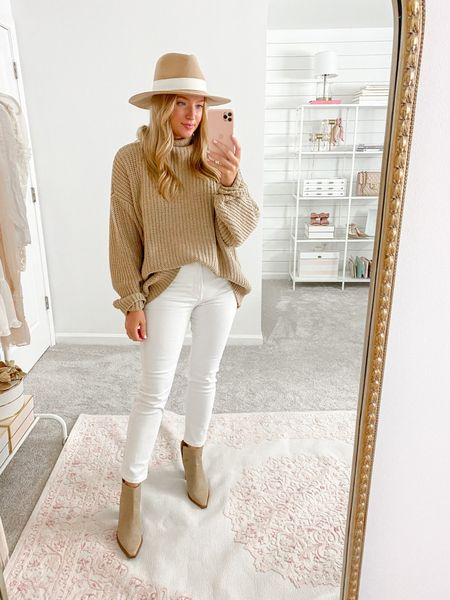 Free people oversized sweater with white jeans and booties