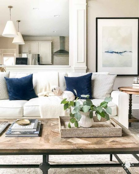 A great place to change things up in your coffee table styling. Home decor living room decor rattan tray pottery barn sofa large wall art minted art   #LTKhome #LTKfamily #LTKstyletip