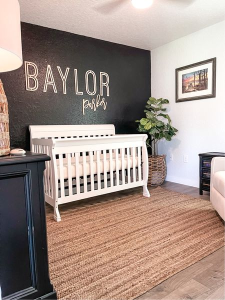 """Baylor's nursery reveal is live on @lacedinlovely ❤️ I love the black accent wall, white crib, and nursery recliner! This recliner is the cheapest I saw (with the aesthetic I was going for) and is so comfy and even better quality than I expected. Nursery decor, baby room , baby boy nursery •Paint:  Sherwin Willams:  Tricorn Black •Wooden name sign: linked (15"""" middle name in Medina font)  •crib:  da Vinci baby kalani 4 in 1 convertible in white  •rug size 5x7  #LTKbaby #LTKhome #LTKbump"""