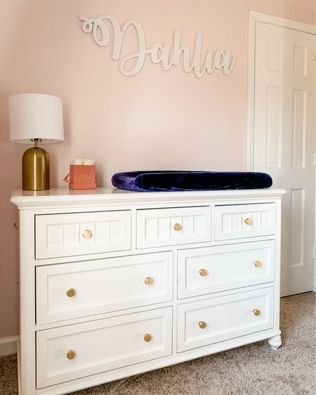 Absolutely loving how sweet baby girl's nursery is coming together, but I need help - should I add something under her name sign?! 💗 Having this pretty paint, gold touches, flowers, and gorgeous name sign in her changing corner makes diaper time enjoyable 🤪 This dresser/changing table was originally Sawyer's, then Teddy's, and to change it up a little for Dahlia we swapped out the original white knobs for these pretty gold ones! The matching lamp is only $20 right now too!!  http://liketk.it/39bEl #liketkit #LTKbaby #LTKfamily #LTKhome @liketoknow.it @liketoknow.it.home @liketoknow.it.family