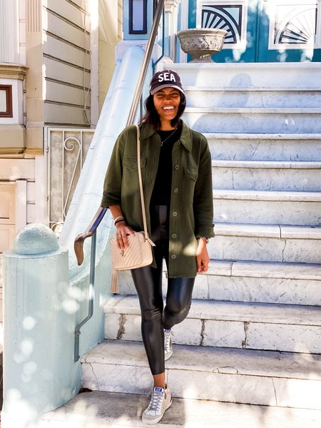 Travel outfit- faux leather leggings, hat, sneakers, Shacket