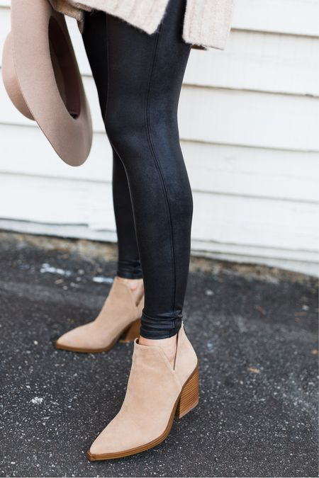 Found my favorite fall bootie of all time! Styled here with sound faux leather leggings. Use my spanx promo code: AMANDAJOHNxSpanx for 10% off