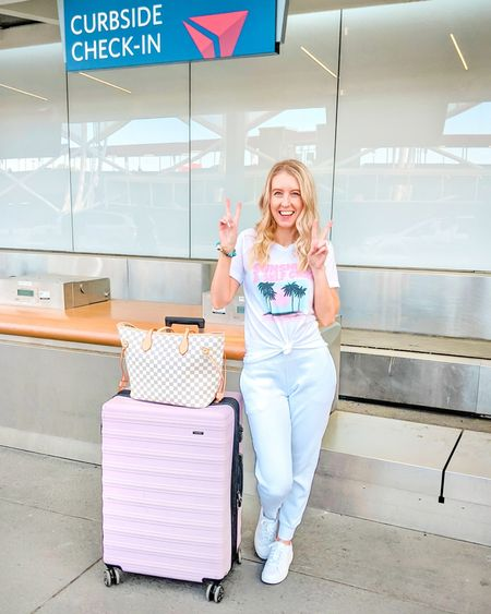 The perfect airport outfit! Cute and comfy outfit to wear while flying or traveling. Pink Lily graphic tee, white fitted joggers, sweatpants, white Nike Court Royale 2 sneakers, white checkered tote bag purse. Travel outfit, vacation outfit, vacation look. http://liketk.it/3fMZL @liketoknow.it #liketkit #LTKstyletip #LTKunder50 #LTKunder100 #LTKshoecrush #LTKitbag
