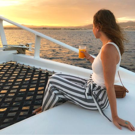 Sunset cruise was beyond magical 😍✨💫🍹 . . . These paperbag @americaneagle pants are still available in a few sizes and are 25% off for #labordayweekend sales! My ribbed tank is 40% off, making it just $9 (also comes in many colors) 🙌🏼 Screenshot to shop this look or follow me on the @liketoknow.it app to see all my outfits🧡 http://liketk.it/2xbdn #liketkit #LTKunder50 #LTKsalealert #paperbagpants #aexme #nordygirl #sunsetcruise #cabo #catamaran #summerstyle #vacationstyle #coolstyle #theeverydaygirl #travelblogger #loscabos