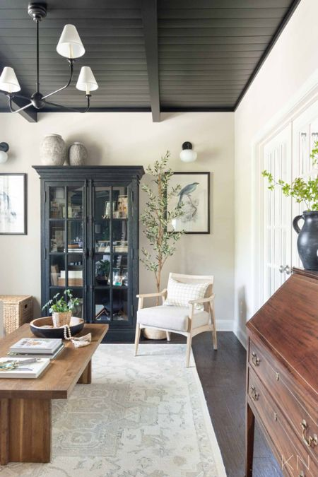 This black shiplap ceiling was added as a special touch when we made over our sitting room. Home decor black cabinet coffee table bird print iron chandelier sconce cane accent chair secretary desk faux olive tree   #LTKhome #LTKstyletip