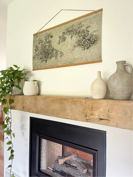 Creating this large scale wall art was so easy! Just use these magnetic poster frames, get printable vintage art, and you're done! Perfect wall art for over the fireplace.   #LTKunder50 #LTKSeasonal #LTKhome