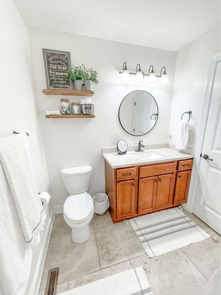 Hall Bath Mini Makeover • from dreary blue to bright and airy! We also got rid of the boring builders grade mirror, added some floating shelves, changed up rugs, towels, shower curtain.   #LTKfamily #StayHomeWithLTK #LTKhome