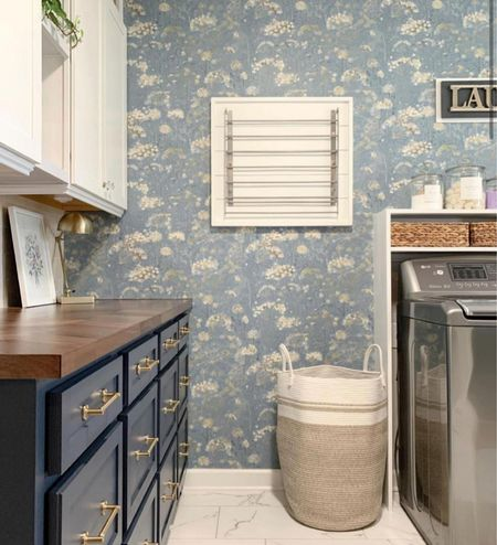 Simple laundry room makeover with gorgeous blue floral wallpaper, white cabinet, and laundry organization! http://liketk.it/3nSsD @liketoknow.it #liketkit @liketoknow.it.home   Follow my shop @thriftydecorchick on the @shop.LTK app to shop this post and get my exclusive app-only content!  #liketkit #LTKfamily #LTKhome #LTKunder100 @shop.ltk http://liketk.it/3nSsD