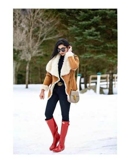 Cozy neutral layers with a pop of red!❤️ #shearlingjacket #hunterboots Outfit details- http://liketk.it/2z7uq #liketkit @liketoknow.it   Follow me on the LIKEtoKNOW.it app to get the product details for this look and others!