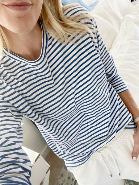 Immediately changes to comfy clothes after work. One of my favorite striped shirts (xs) and sweatshorts (have both pairs linked and love them! Small in both)