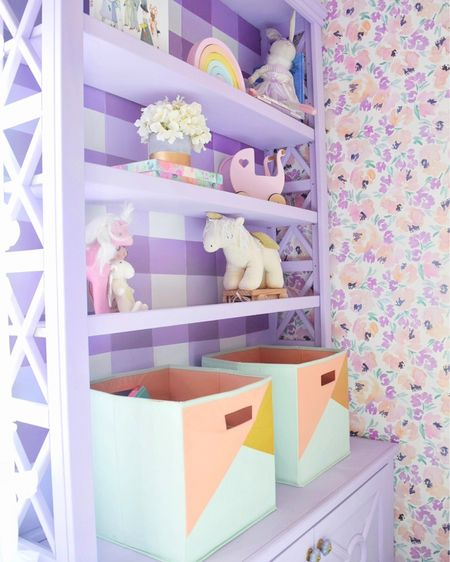 Big girl room 💜 DIY painted buffalo check bookshelves🌸 Genevieve and Georgia's twin girl room makeover with floral wallpaper and purple walls  . .  http://liketk.it/2L2DP  #liketkit @liketoknow.it #LTKbaby #LTKbump #LTKkids #LTKstyletip #LTKunder50 #LTKunder100 #LTKhome @liketoknow.it.home home decor, girl room, nursery decor, room decor, little girls room, flower wallpaper, floral wallpaper, Caitlin Wilson, painted bookshelf, bookshelves, lavender, purple, buffalo check, kid toys, kid room decor, room makeover