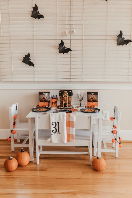 Cute Halloween table for the kids! I love this white kids table to set up for holidays   #LTKHoliday #LTKGiftGuide #LTKSeasonal