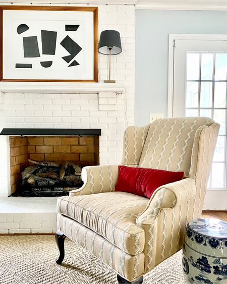 Traditional home decor, wingback chair, buffet lamp, black shade, sisal rug, blue and white garden stool  #LTKhome