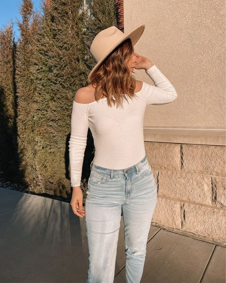This white off the shoulder top is from Vici Dolls. Light blue mom jeans and a beige sand fedora hat. Super cute outfit for spring and summer! #LTKunder100 #LTKunder50 #LTKstyletip @liketoknow.it #liketkit http://liketk.it/3d2Ef