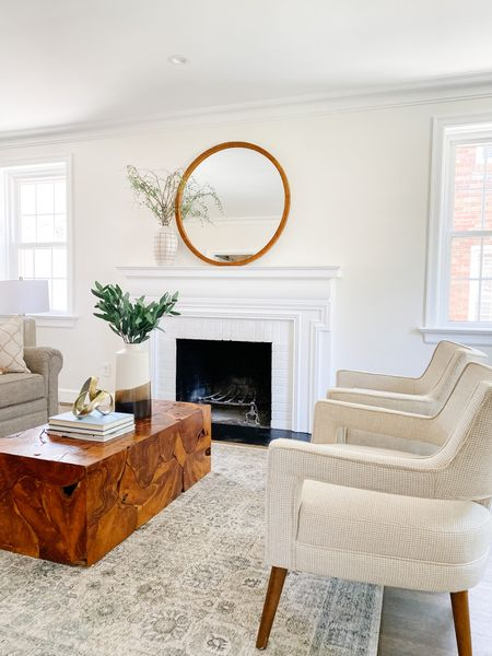Love the contrast of this teak root coffee table with the light furniture.  Wood coffee table, living room decor, living room seating, accent chairs, neutral decor, home decor, round mirror, fireplace ideas  #LTKhome