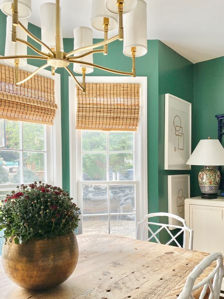 Fall decor, dining room, farmhouse table, brass planter, gold chandelier with shades, bamboo shades, chippendale chair  #LTKSeasonal #LTKhome