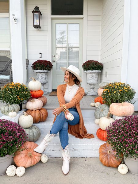 Fall outfits & fall front porch decor! Take 15% OFF my cardigan at gibsonlook! #falldecor #fallfrontporch #pumpkindecor #falloutfits #fallcardigan #thanksgovingoutfit #cowboyboots #mockneckbodysuit   #LTKsalealert #LTKunder100 #LTKstyletip