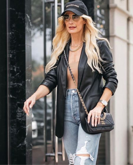 Obsessed with this black faux leather blazer! It runs tts I'm wearing an xs.  Follow my shop @soheatherblog on the @shop.LTK app to shop this post and get my exclusive app-only content!