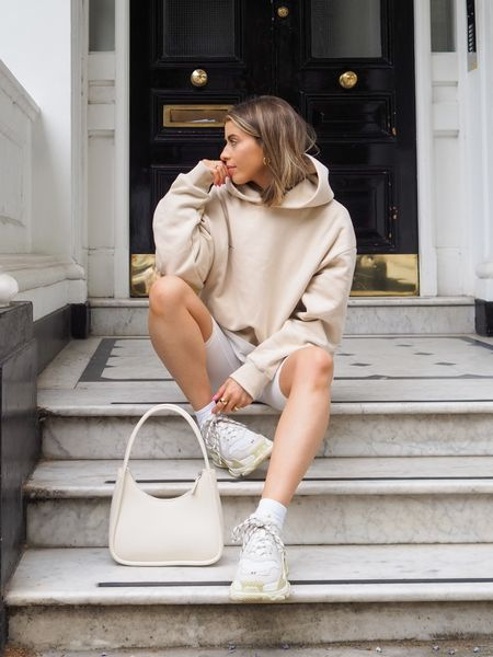 An oversized beige hoodie teamed with a pair of cream cycling shorts is such an easy go to comfy summer look! I've finished it with a pair of balenciaga triple s sneakers and a cream shoulder bag     #LTKSeasonal #LTKeurope