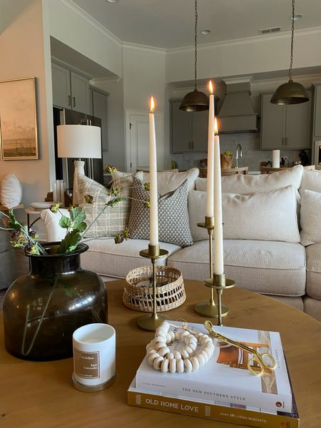 Fall coffee table essentials! Tall taper candles, brass candle sticks, large brown smoked glass vase and faux berry stems! I love these bone beads that add texture along with the rattan baskets for $20!   #LTKunder50 #LTKhome #LTKstyletip