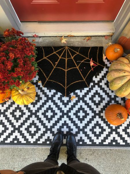 This spiderweb doormat is the perfect spooky touch to a fall/Halloween ready porch!   #StayHomeWithLTK #LTKunder50 #LTKhome