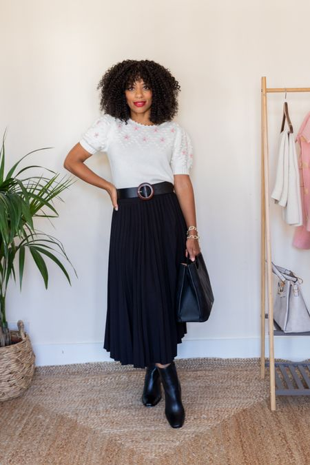 White embroidered short-sleeved knit and black pleated skirt with black ankle boots. Black and white Autumn look.   #LTKeurope #LTKstyletip #LTKSeasonal