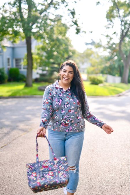 """5% of profits of Vera Bradley new print in Hope Blooms goes to breast cancer research! Use code """"queencarlene"""" for an additional 10% off   Sweatshirt (L), jeans are seven (31, TTS), & shoes are converse (size down 1.5 sizes)  Vera Bradley collection, travel essentials, #verabradley, travel must-haves, backpacks, floral bags, Vera Bradley travel, casual style, midsize, mid size, aerie, light denim jeans, converse, high rise denim, size 12, size 14, high tops, fall fashion, fleece, sherpa   #LTKitbag #LTKHoliday #LTKstyletip"""