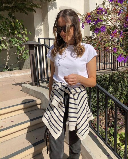 Summer to fall style in a white tee and striped sweater paired with black denim. 🖤🤍  #LTKstyletip #LTKSeasonal #LTKunder100