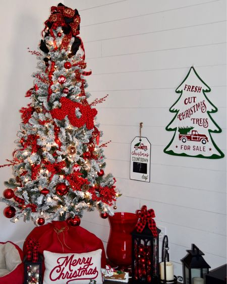 """This 6.5' (7.5 listed too) flocked tree is gorgeous decked out in red and black buffalo plaid,  shatterproof red balls in varying sizes 3""""-10,"""" different strands of red berries and vines. There are a few unique and handmade ornaments, also. Some of the items - signs, lanterns, etc. are similar. @liketoknow.it #LTKhome @liketoknow.it.home http://liketk.it/32A1F #liketkit  #LTKfamily #StayHomeWithLTK Screenshot this pic to get shoppable product details with the LIKEtoKNOW.it shopping app"""