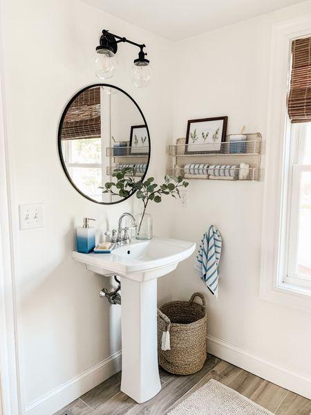 Modern Farmhouse Bathroom with pedestal sink round mirror and blue bathroom decor.     #LTKhome