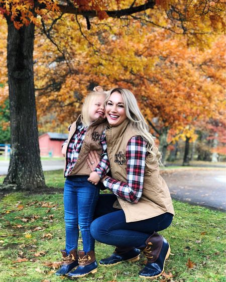 Mommy and me matching outfits for fall fall vest fall boots twinning   #LTKfamily #LTKkids #LTKSeasonal