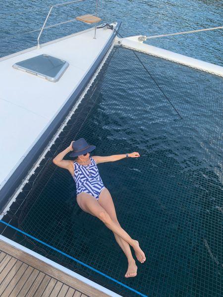 One piece swimsuit and under $30 sun hat http://liketk.it/3jmN1 #liketkit @liketoknow.it #LTKtravel #LTKunder100 #LTKswim