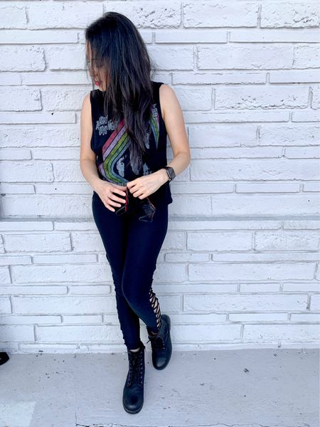 Street style outfit with a sleeveless tank, crisscross leggings and combat boots. Add a purse backpack and a smart watch.   #LTKtravel #LTKshoecrush #LTKunder50