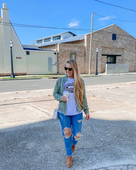 Leopard lips tee layered under olive utility shirt paired with cognac boots and distress high-waisted jeans   #liketkit http://liketk.it/31f8f @liketoknow.it #LTKunder50 #LTKshoecrush #LTKtravel