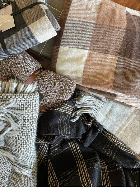 Fall blankets are my fave! Some are wool blankets, plaid throws, checkered blankets and lots of earth tones! Most are under $30 with a few coupon codes.   #LTKunder50 #LTKSeasonal #LTKhome