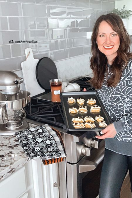 """Do you start your holiday gift shopping early? I'm going to try my best this year! Here are some gift ideas for """"Her"""" from @walmart and they are perfect for friends and neighbors. #sponsored Baking some homemade cookies (like my Iced Pumpkin Mummy Cookies) is always a thoughtful gift and what makes it more special is to add in some cookie sheets and seasonal kitchen towels! Who can use some new cookie sheets? I know my old ones weren't looking the best lol.  Everyone loves getting a yummy holiday scented candle as a gift, too. I linked this Fall """"Pumpkin Butter"""" one (yum!) and some Christmas scented ones for you as well. I wanna know, who's on team Early Shopper?  Head to stories today for my """"Iced Pumpkin Mummy Cookie"""" RECIPE and get the shopping links for the cookies sheets, candles, towels, mixer, & more. The gift ideas & recipe will also be saved to my blog www.modernfarmhouseglam.com and follow me on the LTK app for these cute gift ideas source and more.    #WalmartHome #modernfarmhouseglam #holidaygiftguide #christmasgiftsforher #christmasgiftsforhome #holidaybaking #pumpkincookies #halloweenbaking #falldecor #christmasdecor #kitchendecor #kitchen #seasonaldecor #homedecorideas #holidaygiftideas #fallbaking #smmakelifebeautiful #homeinspo #kitchenideas #christmasbaking #kitchendesign #modernfarmhouse #interiorinspo #christmas2021 #christmasgifts #bakingspiritsbright #cozyhome #cozyfall #fallfarmhouse    #LTKHoliday #LTKGiftGuide #LTKhome"""
