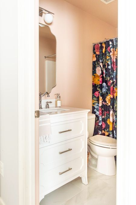My office bathroom just had a makeover! Home decor bathroom decor pink bathroom farrow & ball setting plaster floral shower curtain sconce mirror chrome faucet foaming soap dispenser   #LTKstyletip #LTKhome