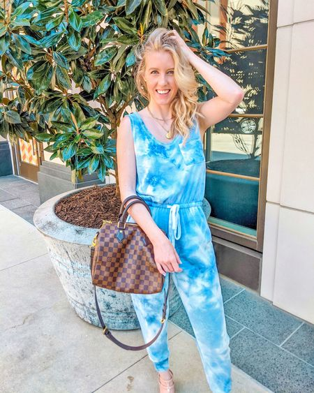 Pink Lily Boutique blue tie dye jumpsuit. Exact sold out - similar linked. Also comes as a romper. Lookalike bag linked. Perfect travel outfit for the airport. Wearing size small. http://liketk.it/3hhWs @liketoknow.it #liketkit #LTKunder50 #LTKunder100 #LTKtravel