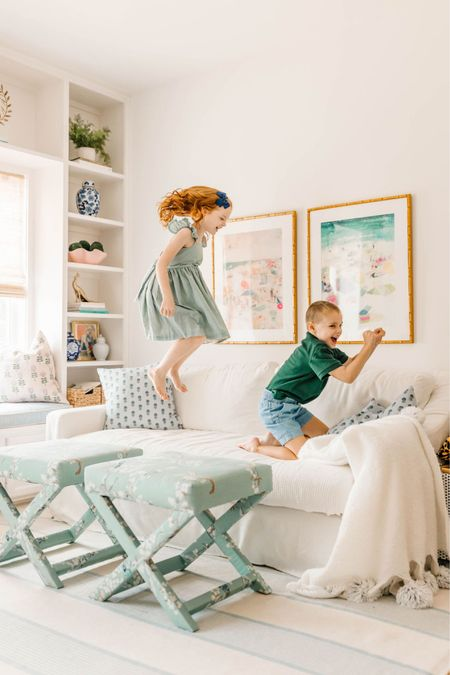 Quite possibly my favorite picture of our entire session because it captures them so perfectly! We love our bright and airy family room with x-benches and a white couch!   #LTKfamily #LTKhome