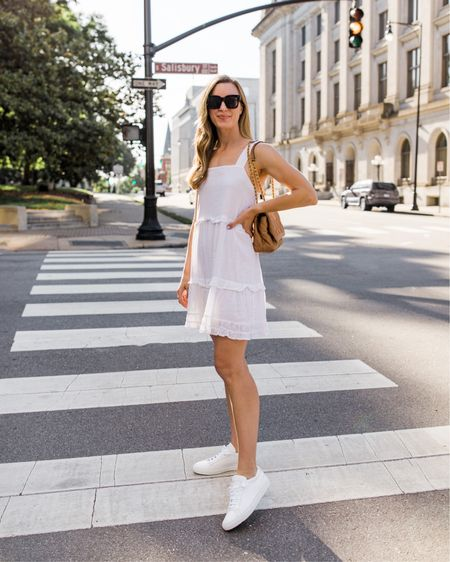 """Sweetest little white mini dress for summertime. It's under $200 and hits at just the right spot (I'm 5'9""""). Lined—not see through unless in very, very direct sun. ☀️ I linked similar Amazon white sundress options and more casual mini dresses below! xo! ✨     summer dress white, casual summer outfit, summer date night dress, summer date night outfit, white dress with sneakers, common projects sneakers, luxury sneakers, Celine sunglasses lookalike, summer fashion, summer style, summer outfits, tiered dress, casual dresses summer http://liketk.it/3fDtP #liketkit @liketoknow.it   #LTKunder100 #LTKshoecrush #LTKSeasonal"""