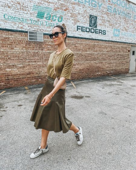 Loving this spring monochromatic look! This padded shoulder top is perfection styled with an olive leather skirt! http://liketk.it/3euow #liketkit @liketoknow.it #LTKstyletip