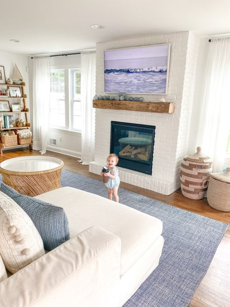 Living room, coastal decor, Serena & lily, baskets, blue, fireplace  #LTKhome #LTKstyletip #LTKSeasonal