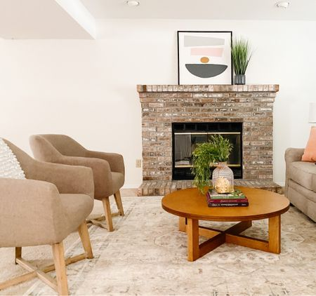 Mid century style barrel chairs and a round wood low profile coffee table.  Living room decor, living room furniture, accent chairs, wood coffee table  #LTKhome