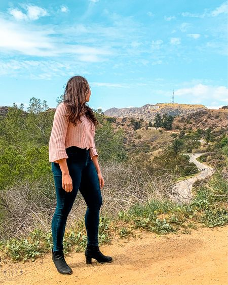 STORYTIME ✨⠀ ⠀ OK, so the day we climbed up the hill at Griffith Park to see the Hollywood sign...⠀ ⠀ I didn't know that we were climbing up a hill to see the Hollywood sign 😂 ⠀ ⠀ Otherwise, I would NOT have worn heels! Even so, it was worth the trek to catch a glimpse of this view. ⠀ ⠀ Did you know that the Hollywood sign was originally supposed to be temporary? It was built in 1923 as an ad for the Hollywoodland real estate development and was only supposed to last about a year and a half.⠀ ⠀ The first time we visited LA (circa 2010) the Hollywood Sign was actually covered in a protest to save it. Swipe to see it, pulled out of the family archives 👉👉👉⠀ ⠀ Have you ever realized too late that you *totally* wore the wrong shoes?!⠀ ⠀ ⠀ P.S. HAPPY INTERNATIONAL WOMEN'S DAY FRIENDS! ⠀ ⠀ ⠀ ⠀  http://liketk.it/3a1wb #liketkit @liketoknow.it    #lovetheview #theeverygirltravels #girlstravel #lovethisplace #southerncalifornia #explorecalifornia #hollywoodsign #travelcalifornia #explorela #griffithpark #hollywoodsignhike #griffithparktrails #explorelosangeles #timeoutla #welikela #mydayinla #discoverla #loves_united_states #la_p1x #californiacaptures #doinla #travelgirlgo #girlswholiketravel #adventureladies #femaletravelinspo #woman_in_landscape #thepurposelylost #usa_greatshots