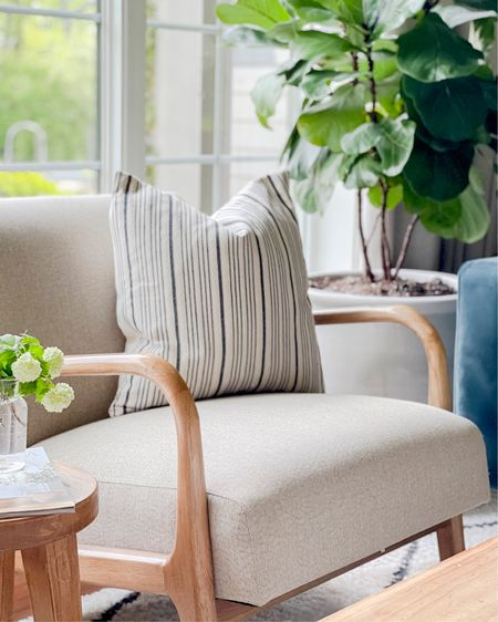 My favorite accent chair is back in stock! I love the curved wood arms. And I've rounded up some beautiful pillow covers as well as similar accent stools for you. Enjoy the weekend! #pillowcover #armchair #accentchair #livingroom #throwpillow @liketoknow.it #liketkit http://liketk.it/3gO0I @liketoknow.it.home #LTKhome #LTKunder100 #LTKunder50