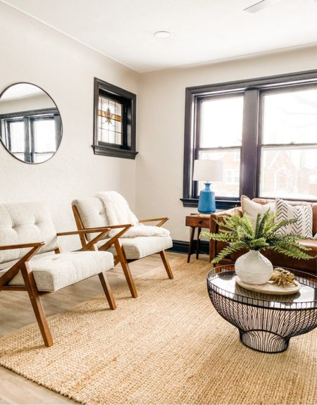Love these mid century modern accent chairs because they keep the living room light and open.  Accent chairs, living room, mid century decor, round mirror, home decor  #LTKhome