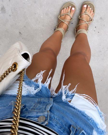 Amazon summer finds. Gladiator sandals size 7. Levi's shorts size 25. Nordstrom cami size small. Gucci white crossbody bag   http://liketk.it/3hQVb #liketkit @liketoknow.it #LTKunder50 #LTKsalealert #LTKunder100 #laurabeverlin